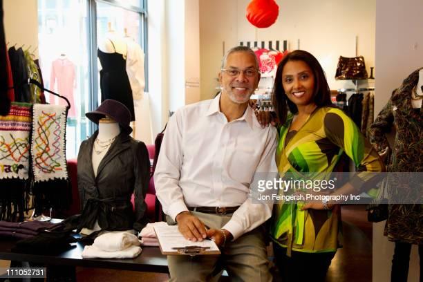 small business owners standing in clothing shop - maryland staat stockfoto's en -beelden