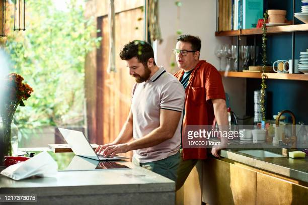 small business owners working from home during lockdown - laptop stock pictures, royalty-free photos & images