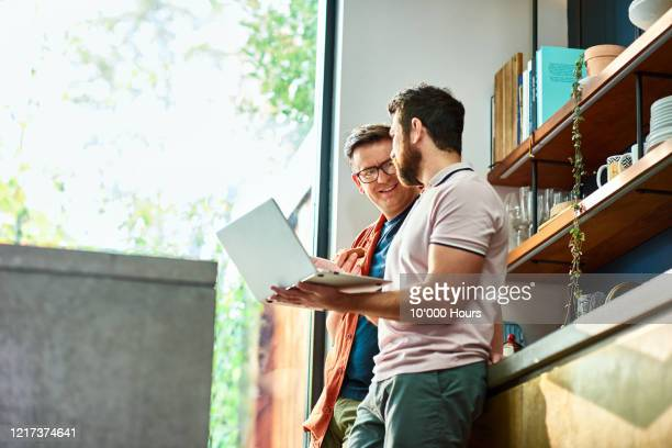 small business owners working from home using laptop - laptop stock pictures, royalty-free photos & images