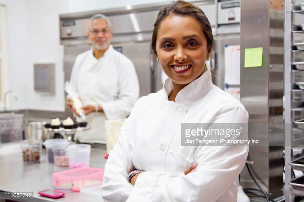 Small business owners working in bakery kitchen