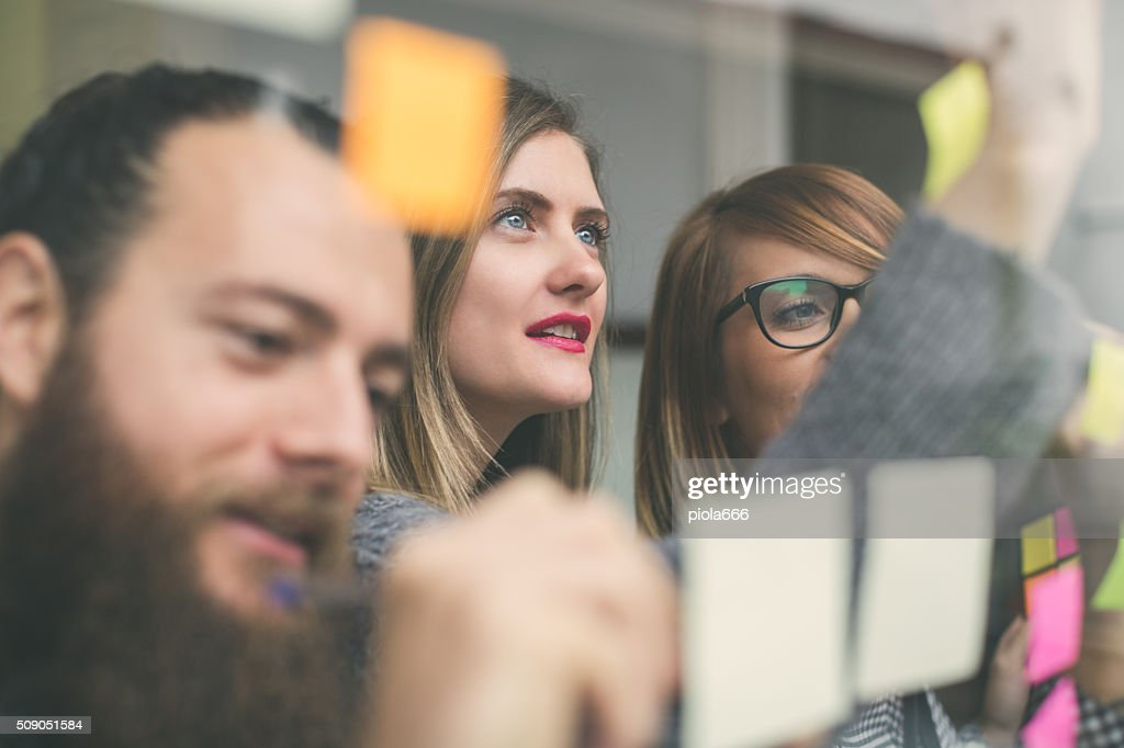 Small business start up team: briefing with notes : Stock Photo
