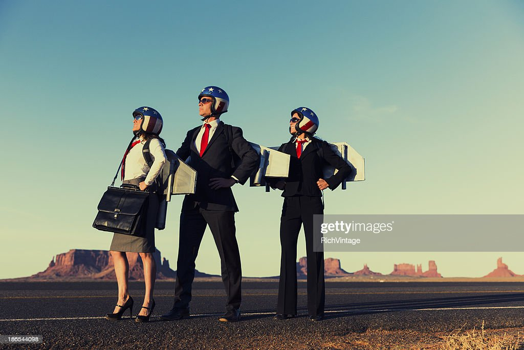 Small Business Team dressed in Jetpacks in Monument Valley : Stock Photo