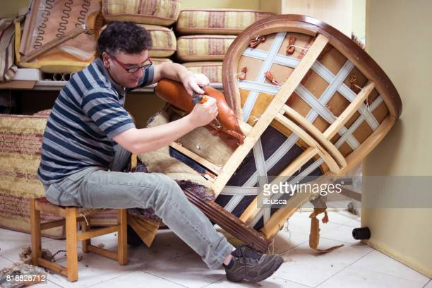 Small business upholsterer laboratory: Disassembling antique armchair