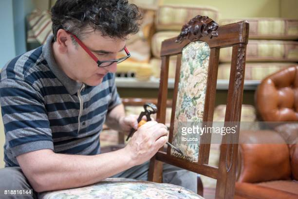 Small business upholsterer laboratory: Disassembling antique chair