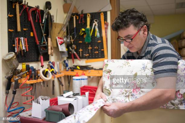 Small business upholsterer laboratory: Repairing sofa