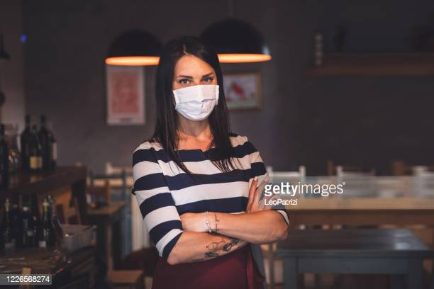 small business, woman owner portrait with protective face mask - essential services stock pictures, royalty-free photos & images