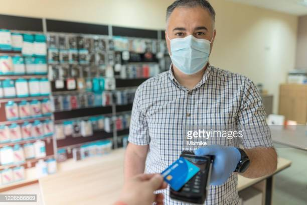 small business working amid coronavirus - new normal stock pictures, royalty-free photos & images