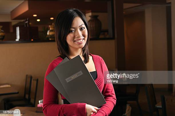 Small Business—Asian Woman Restaurant Owner, Host and Maître' d