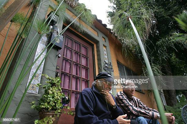 Small businessmen Jeff Serber right and his father David sit surrounded by new landscaping they added in front of one of their units with original...