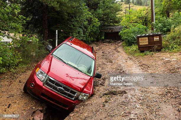 CONTENT] A small cabin sits in the middle of the dirt road above a resident's which is wedged in a gap created by the flood waters The driver was...
