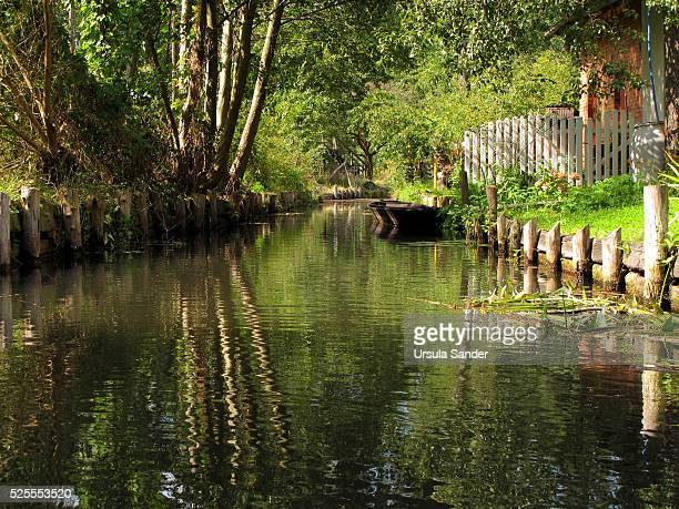Small canal with empty boat in Spree Forest, Brandenburg, Germany