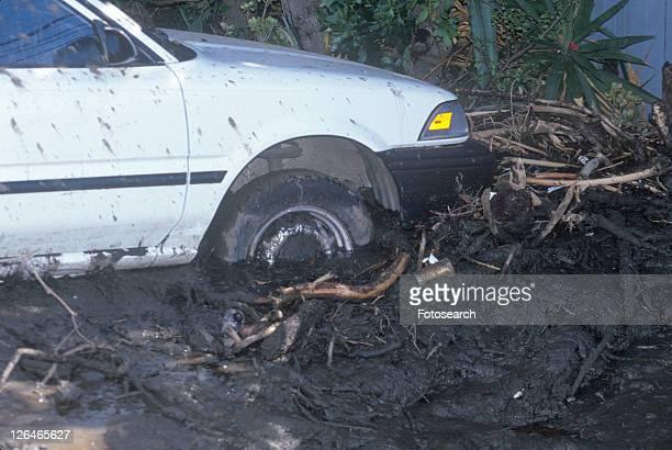 A small car stuck after the mudslides