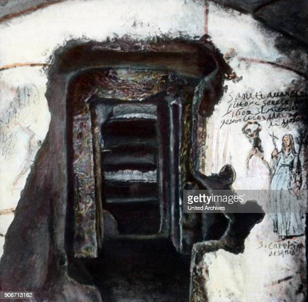 A small cave with places for burials at the catacomb area near Rome Italy 1920s