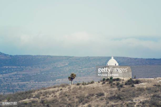 a small chapel in landscape along highway in mexico - puebla mexico stock pictures, royalty-free photos & images