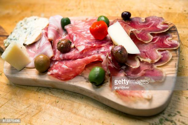 small charcuterie plate with ham, salami and prosciutto - charcuterie board stock pictures, royalty-free photos & images