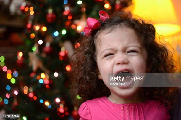 a small child crying at christmas - southern christmas stock pictures, royalty-free photos & images