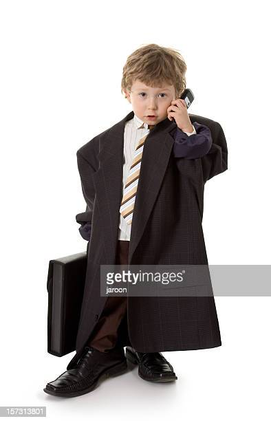 small child dressed like businessman