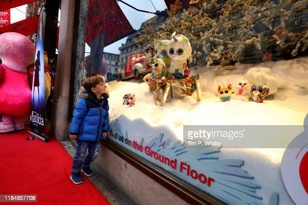 A small child gazes into the Hamleys Christmas display at Regents Street on November 1st in London England