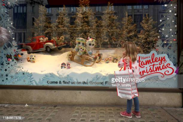 A small child gazes into the Hamleys Christmas window display on Regents Street on November 1st in London England