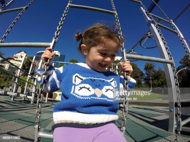 Small child girl plays in the playground
