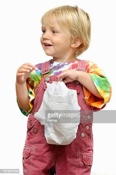 Small child holding a clean diaper