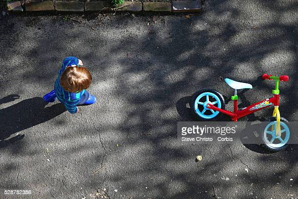 A small child rides a bicycle in a suburban street Sydney Australia Friday 5th July 2013Photo