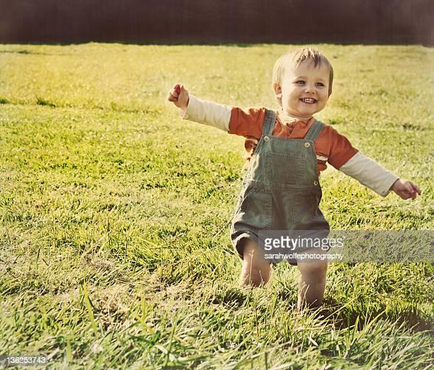 Small child running through grass