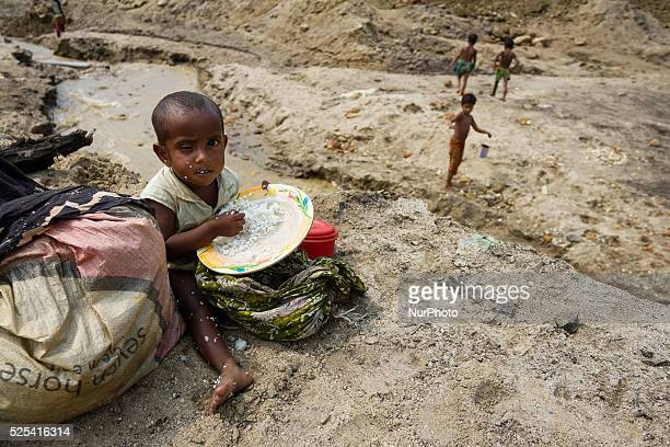 A small child was taking only rice since his parents couldn't afford anything for his lunch at the stone extraction site in Jaflong Sylhet Bangladesh...