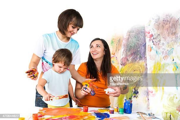 Small children draw paints around