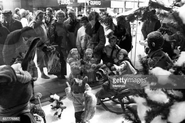 Small children look wide eyed into Fenwick's sparkling window display. 6th November 1987.