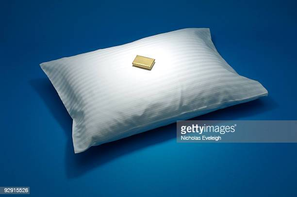small chocolate on a white pillow - pillow stock pictures, royalty-free photos & images
