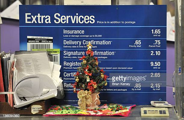A small Christmas tree is displayed on a table in a sorting room at the Main Post Office on December 19 2011 in Chicago Illinois US Postal Service...
