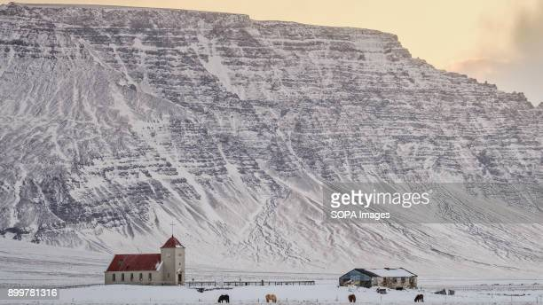 Small church and mountains near Borgarnes Iceland is one of the Nordic nations in Europe With its population estimated at just over 330000 in 2017...