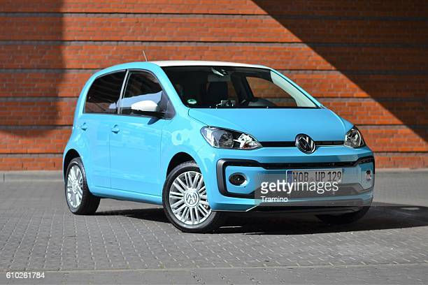 small city car on the street - volkswagen stock pictures, royalty-free photos & images