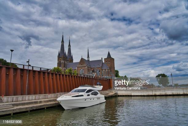 small city harbor of the dutch town cuijk, netherlands - dutch harbor stock photos and pictures
