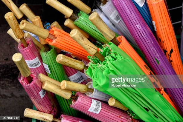 Small colorful umbrellas or parasols made in China for sale at a Fourth of July holiday event in Santa Fe New Mexico