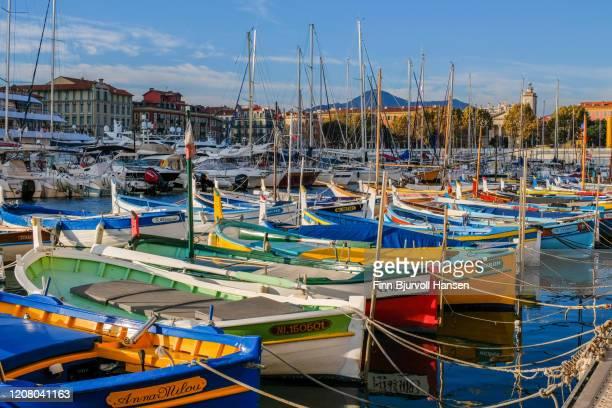 small colorfull boats in the harbour of nice - finn bjurvoll foto e immagini stock