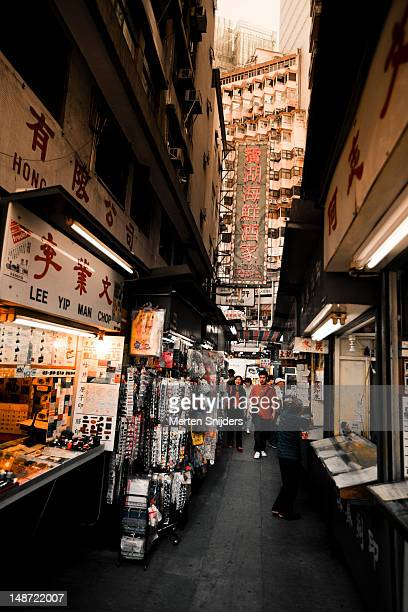 small commercial alley between central and sheung wan. - merten snijders stock pictures, royalty-free photos & images