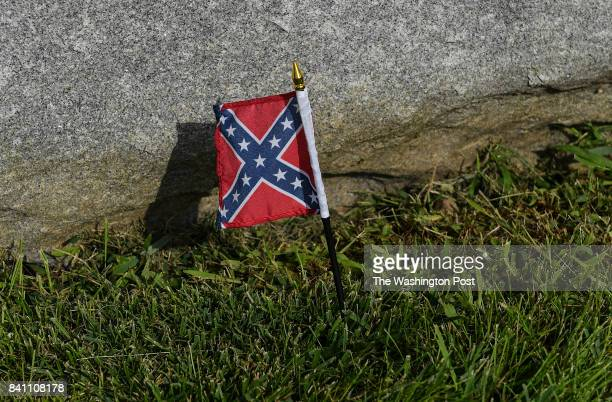 A small Confederate Flag is seen at the Gen Robert E Lee statue at The Newcomer House at Antietam National Battlefield on August 23 2017 in...