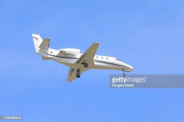 small corporate jet prepares to land - 自家用飛行機 ストックフォトと画像