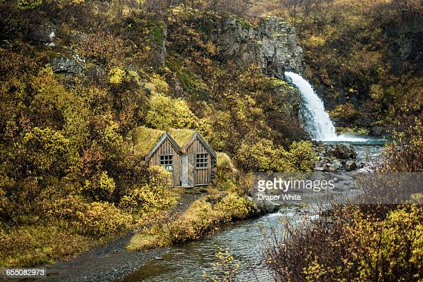 small cottage near waterfall. - skaftafell national park stock photos and pictures