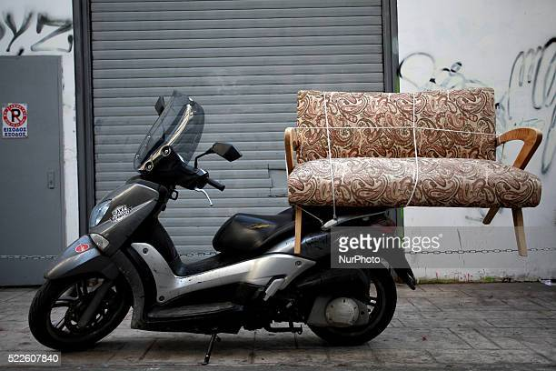 A small couch carried by a scooter in Athens April 6 2016