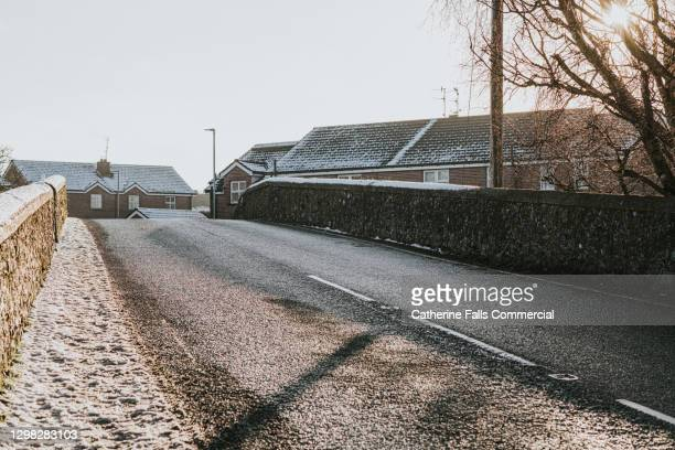 small country road bridge covered in a light frost - falls road stock pictures, royalty-free photos & images
