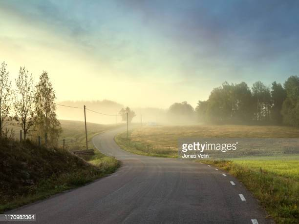 small country road trough beautiful landacape - non urban scene stock pictures, royalty-free photos & images