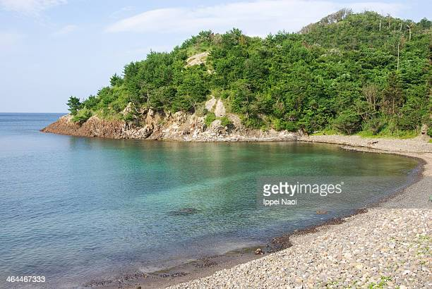 Small cove beach with clear calm water, Shimane