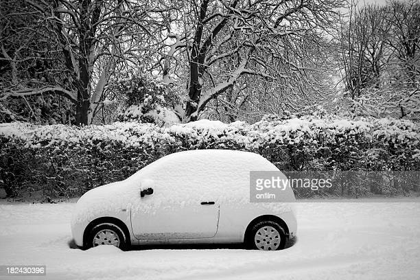 small covered  in snow parked on the street - deep snow stock pictures, royalty-free photos & images
