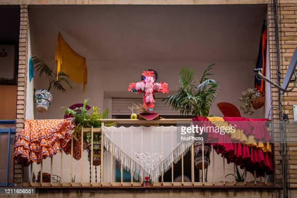 Small cross surrounded by flamenco dresses anda manila shawls during the celebration of Dia de la Cruz on the balconies of the city on May 02, 2020...