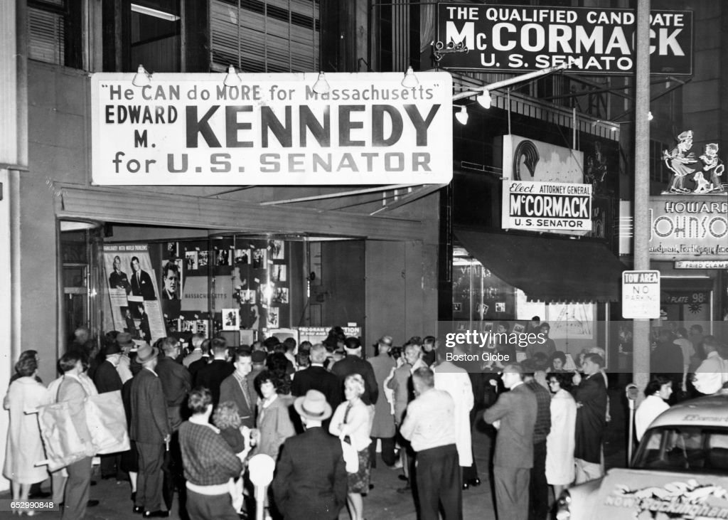 A small crowd gathers around a television set at Kennedy headquarters in Boston to hear the Holyoke, Mass., debate between Edward Kennedy and Ed McCormack on Sept. 5, 1962.