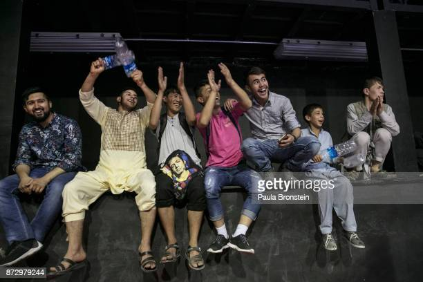 A small crowd of friends and relatives cheers during the fighting at the SLFC amateur event ON MAY 18 in Kabul Afghanistan Sports like Cricket and...