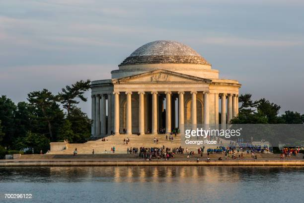 A small crowd of people tour the Jefferson Memorial as the sun begins to set on June 4 2017 in Washington DC The nation's capital the sixth largest...